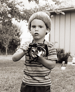 Me about 30 years ago with a Brownie Flash camera.